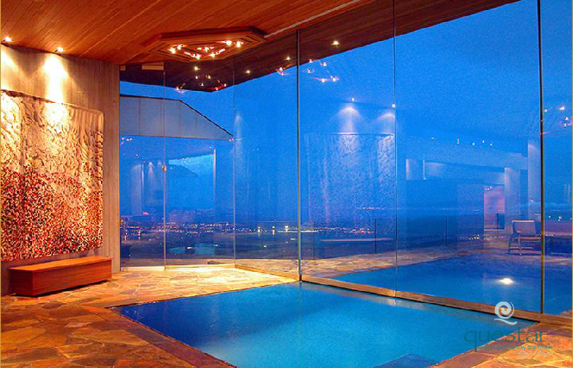 Indoor/Outdoor pool divided by glass wall