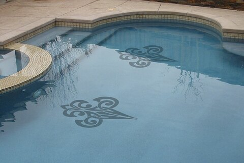 Stylelized pair of mosaics in pool near steps