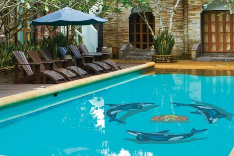 Porpoises swimming in circle mosaic in pool